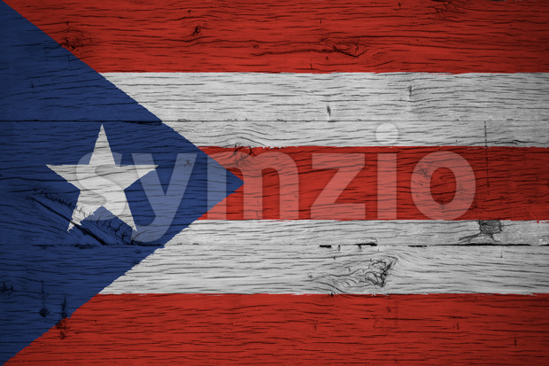 Puerto Rico national flag painted on old oak wood. Painting is colorful on planks of old train carriage.