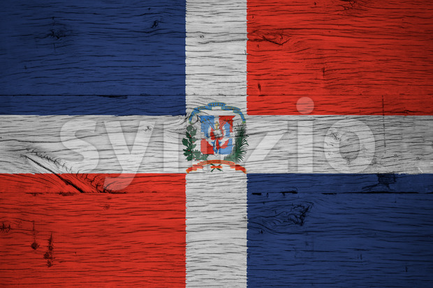 Dominican Republic national flag with coat of arms painted on old oak wood. Painting is colorful on planks of old ...