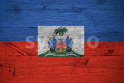 Haiti national flag coat arms painted old oak wood Stock Photo