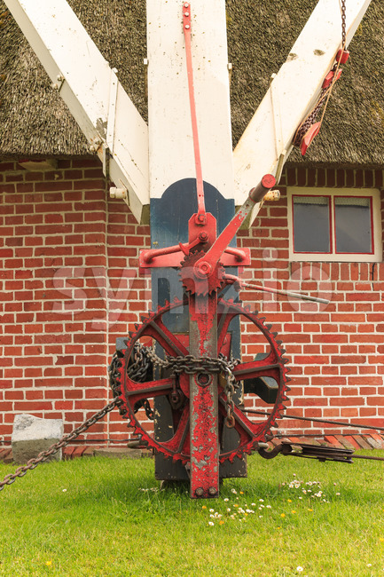 Machinery with gear to rotate head of historic windmill Stock Photo
