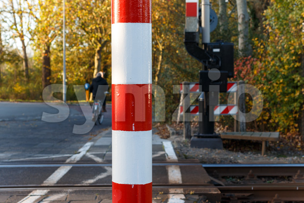 Close-up pole of railway crossing Stock Photo