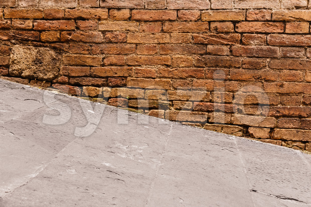 Steep walkway and old wall Stock Photo