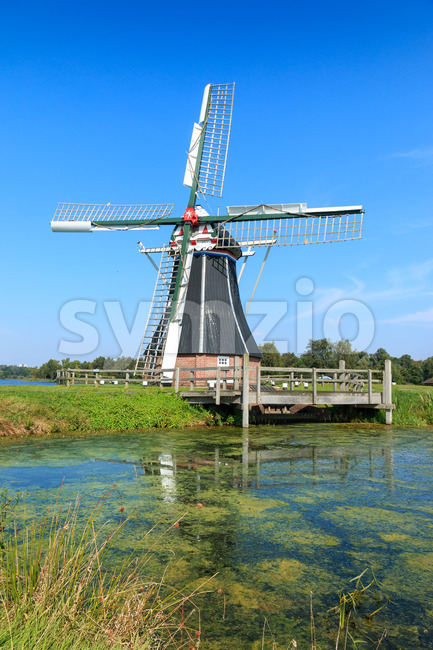 Historic windmill De Helper in Groningen, The Netherlands Stock Photo