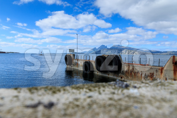 Old ferry dock in fjord in Norway, Europe Stock Photo
