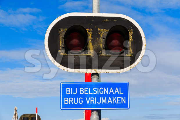 Bycicle bridge warning sign and lights Stock Photo
