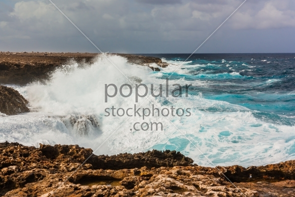 Waves splashing on rocks Bonaire