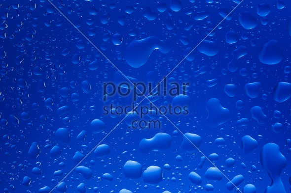 Drops water glass blue background