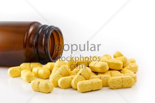 Yellow pills emptied bottle