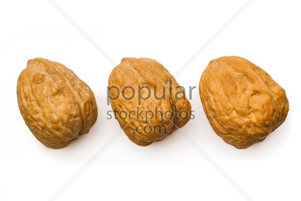 Three walnut isolated white top